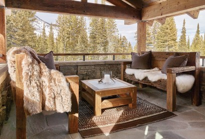 An outdoor seating area connects to Wyoming's trapper history with furs as accents to the hewn outdoor furniture.