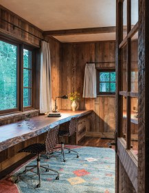 A single slab of rough-edged fir was used to create a streamlined, built-in desk in an office. A custom rug from Kismet Gallery in Jackson adds sophistication to the space.