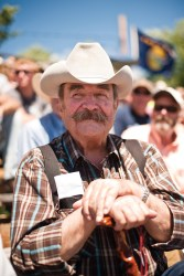 A Sun River resident tentatively watches the action in the arena.