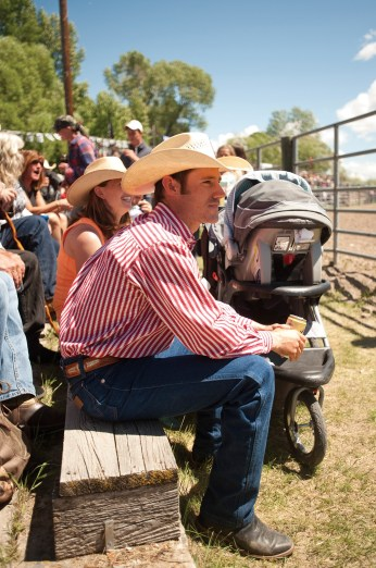 In the grandstands there's no shortage of cowboys wearing crisp shirts — Coors in hand — with a stroller parked nearby.