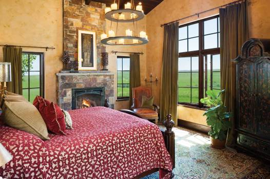 With windows on three sides, the master bedroom seems to perch above the landscape.