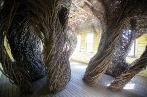 """Patrick Dougherty's art piece, """"Daydreams,"""" wraps a newly built (but designed to appear old) 19th century schoolhouse in locally sourced willows."""