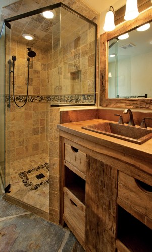 The bathroom features a walk-in shower and reclaimed, hand-hewn counters.