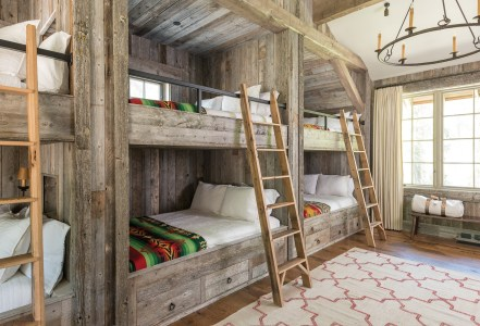 """Mary wanted a bunk room where she could really pack in a bunch of kids,"" says architect Kevin Burke. She opted for three sets of queensized bunks to accommodate up to 12 guests."