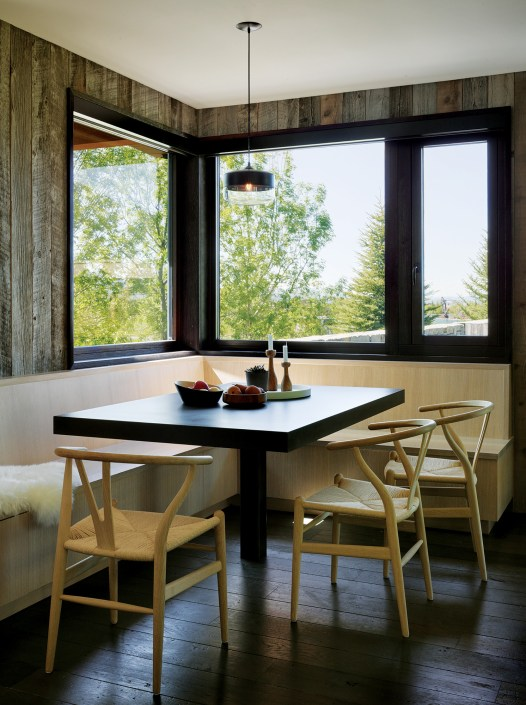 Reclaimed barnwood, sleek and classic seating options, and fantastic scenery combine to create an attractive and functional breakfast nook.