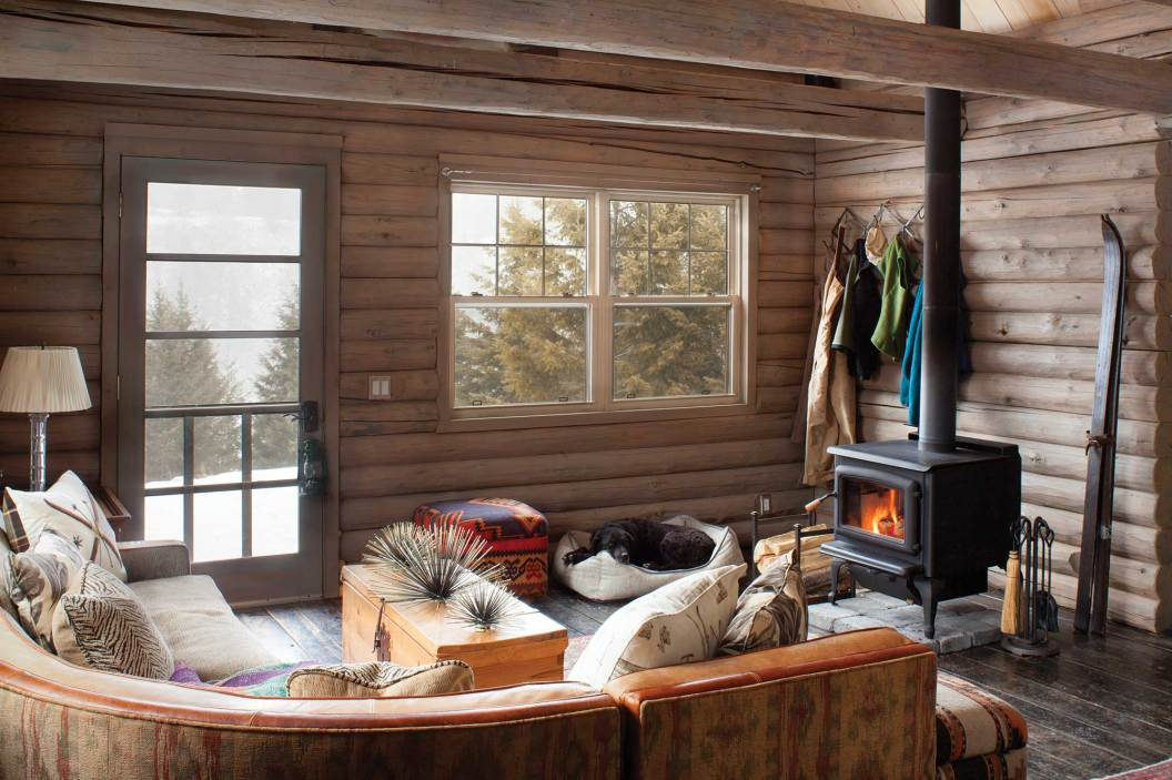 Situated near a wood-burning stove, the couch is a cozy spot for reading, reflection and relaxation.
