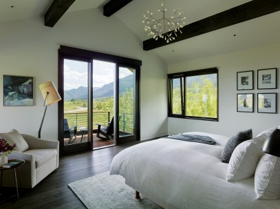 The master bedroom opens up to a sunny deck perfect for relaxing.