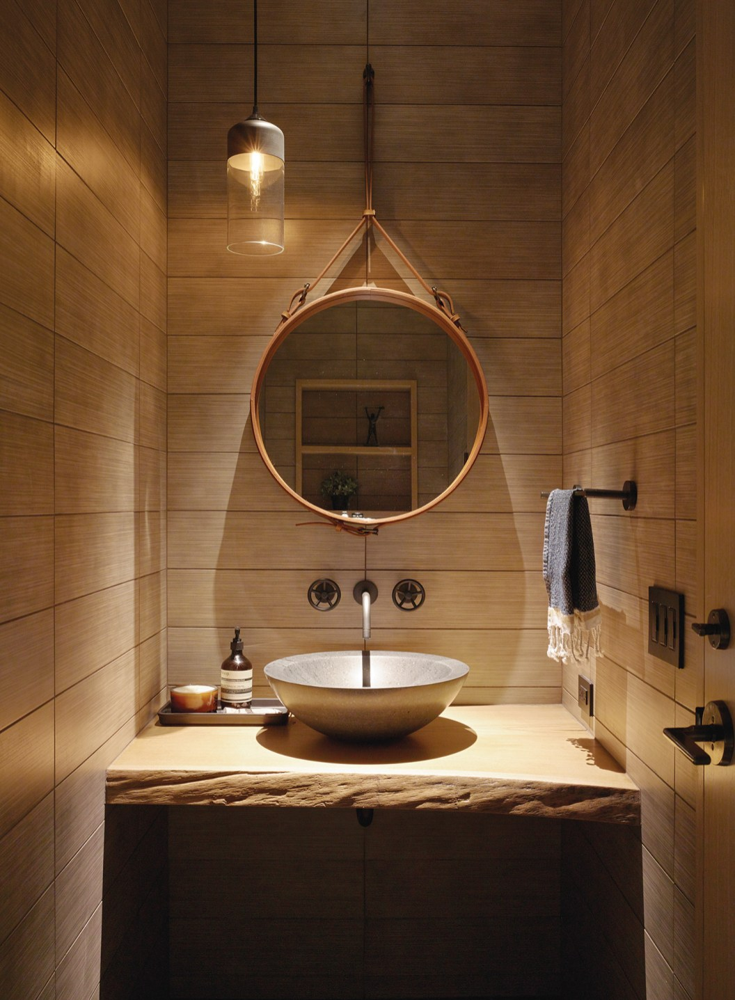 Scandinavian simplicity and mountain living combine in this functional and attractive bath.