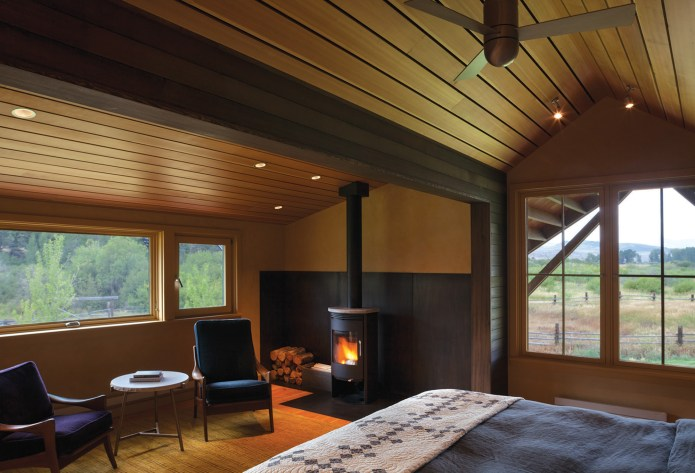 "The master suite, although still modest in size, is the largest bedroom in the home. The family was ""anti-big bedroom,"" preferring to spend most of their time outdoors. The south facing views off the master bedroom open up to a ridge where elk frequently graze"