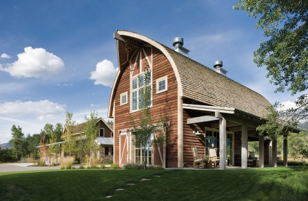 Recreating the gothic form of neighboring barns in the Springhill community, the new structure was designed to respectfully blend in.