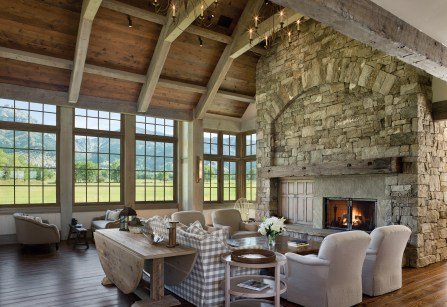 The vault of the great room punctuates the elegance of the timbers and capitalizes on bucolic views through oversized mullioned windows.