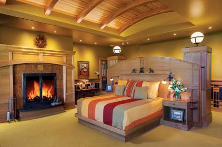 The master bedroom includes a cozy fireplace and an architecturally designed headboard made specifically for the space.