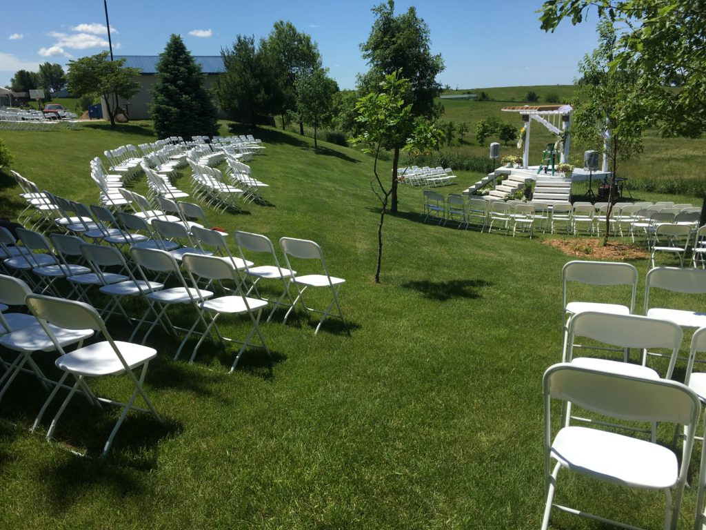 folding circle chairs glider rocking chair parts standard white rental iowa city cedar rapids ia outdoor wedding at highpoint church with in half
