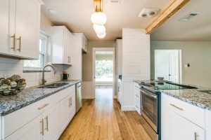 Modern kitchen in this Euless remodel