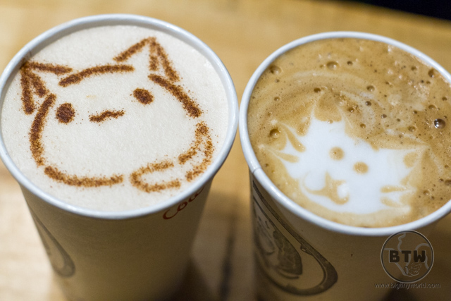 Two lattes with cat art in the foam