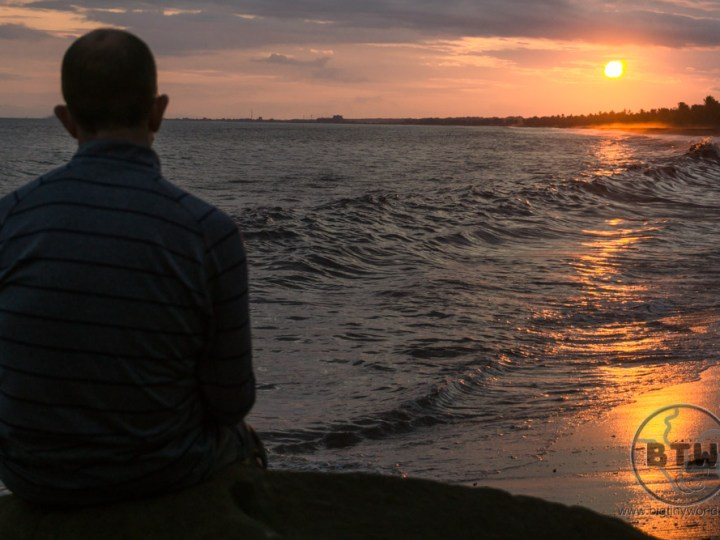 Aaron silhouetted against the golden sunset over the Doubletree Resort in Puntarenas, Costa Rica | BIG tiny World Travel