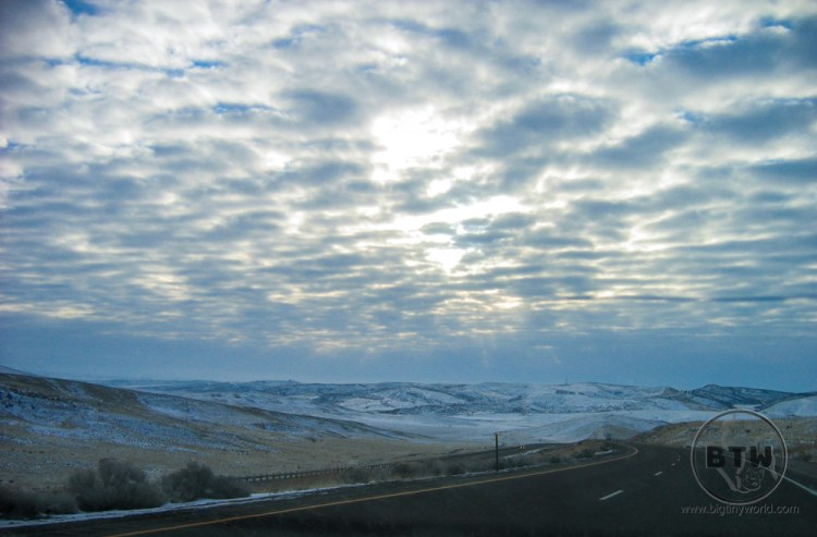 A winter highway in Idaho under cloudy skies