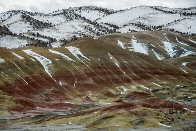A view of the snowy Painted Hills from above in Central Oregon