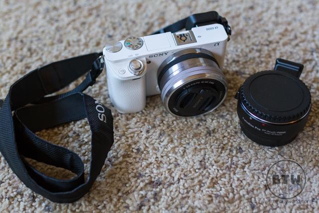 A white Sony a6000 camera and adaptor | BIG tiny World Travel