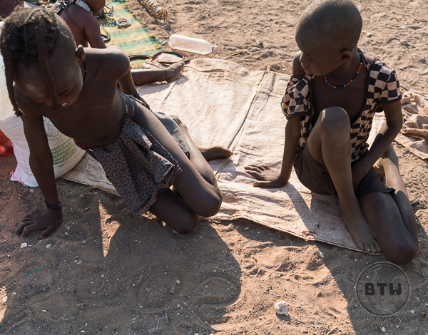 Himba tribe children writing Sony and Canon in the dirt