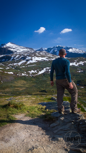 Aaron standing on the edge of mountain in Norway