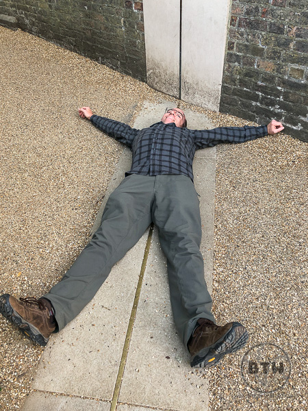 Aaron lying on the Prime Meridian Greenwich UK
