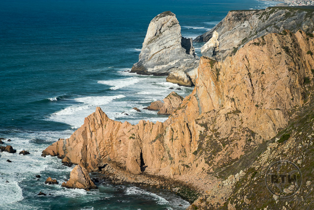 Large rocks in the ocean at the coast of Cabo da Roca in Portugal