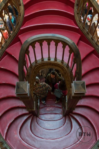 The red stairs in Lello Bookstore in Porto, Portugal