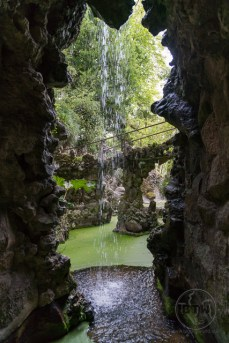 A small waterfall from behind at Quinta de Regaleira, Sintra, Portugal