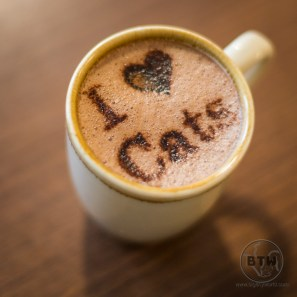 """Latte with text in the foam that spells """"I"""