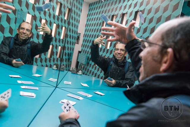 Aaron playing cards with a few of his clones at the Illusion Museum in Zagreb, Croatia