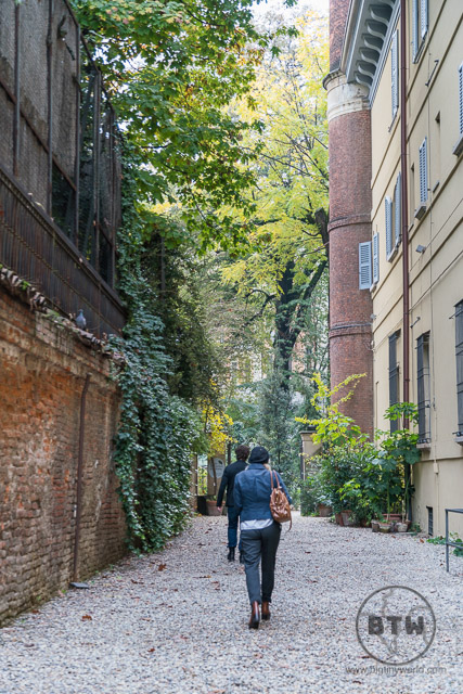 People walking toward a garden in Milan, Italy