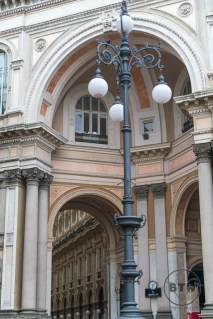 Lamp post at the entrance of the indoor market in Milan, Italy