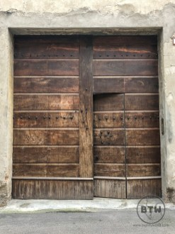 Open wooden door in Reggio Emilia, Italy