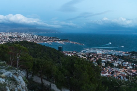 A dusk view of the city and departing ferries from the western hill in Split, Croatia