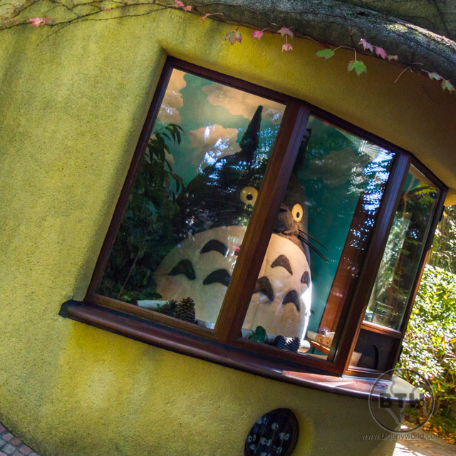 A giant Totoro sitting in a ticket booth at the entrance to the Ghibli Museum in Mitaka, Japan