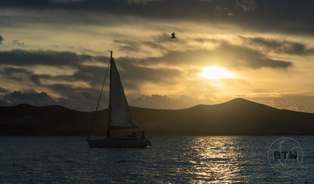 A sailboat in front of a setting sun in Zadar, Croatia