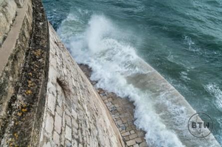 A wave crashing into the waterfront at Zadar, Croatia