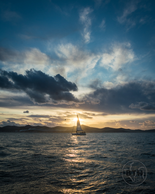 A sailboat in front of the sunset in Zadar, Croatia