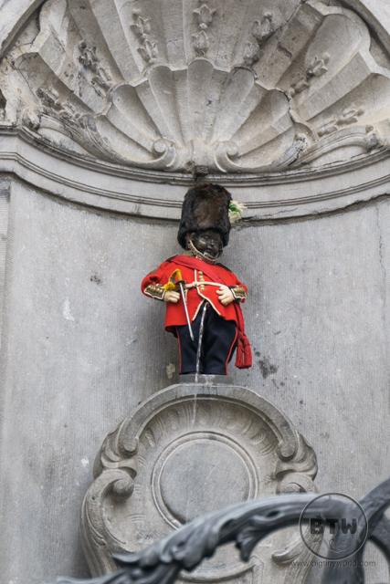 Manneken Pis fountain dressed as a London Guard in Brussels, Belgium