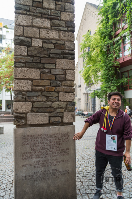 Our tour guide, Andre, talking about the Neil Armstrong pillar monument in Cologne, Germany