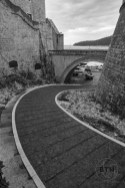 A path winding under an overpass in Dubrovnik, Croatia