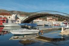 An arching footbridge over a canal in Trogir, Croatia