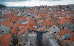 Aaron looking over the orange rooftops of Dubrovnik from its wall in Croatia