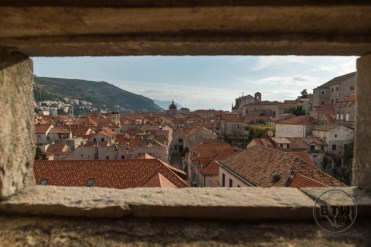Looking through a hole in the wall in Dubrovnik, Croatia