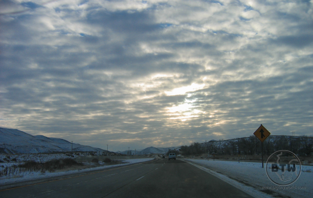 A wintery highway in Idaho under cloudy skies