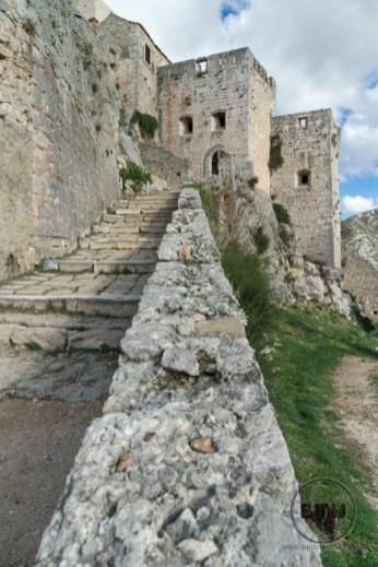 Going up steps at Klis Fortress near Split, Croatia