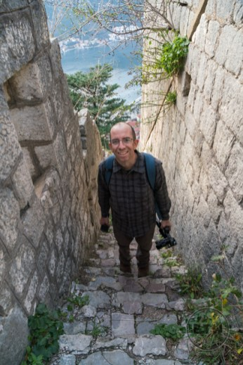 Aaron standing on some steps at the Kotor fortress ruins in Montenegro