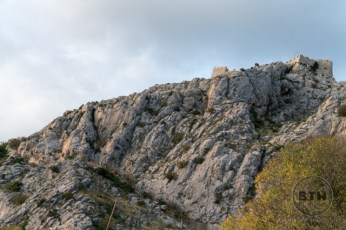 A fortress at the top of a rocky cliff in Omis, Croatia