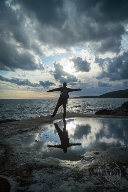 Aaron posing in front of the sunset at the coast in Tivat, Montenegro